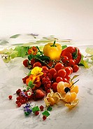 Various berries, fruit and vegetables on marble