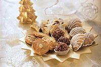 Assorted Christmas biscuits & sweets on star-shaped plate