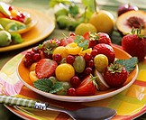 Fruit salad with summer fruit and lemon balm