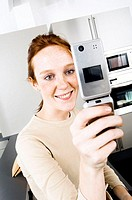 Close-up of a young woman operating a mobile phone