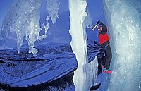 Ice climber climbs frozen waterfall in Norwegian Hemsedal