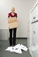 Woman dropping files