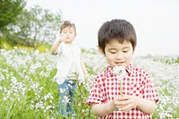 Two children standing in a field
