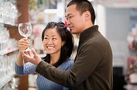 Couple shopping for wine glasses
