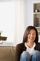 Mature woman in living room (thumbnail)