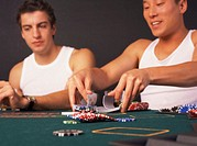 Two young men playing poker