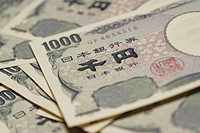 Stack of new Japanese 1000 yen bill, close-up