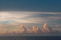 Cloudscape over ocean at sunset (soft focus)