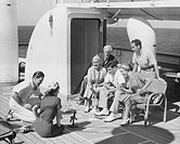 Group of people playing game on deck, of cruise ship B&W), (B&W)