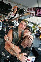 Main Street, Iron Horse Saloon, female bass guitarist, senior couple dance, Bike Week. Daytona Beach. Florida. USA