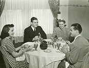 Two couples having dinner, (B&W)