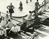 Group of people at swimming pool, (B&W), elevated view