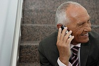 Manager talking on his cell phone