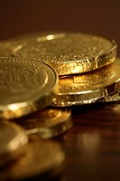 Chocolate shaped like coins, close-up, selective focus