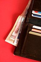 Purse with credit cards and bills (part of), close-up