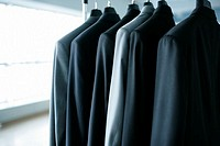 Suits hanging on a clothes rail in a company hall