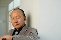 Asian businessman looking on his watch