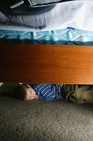 Boy, 5, sleeping under his bed.