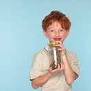 Boy Holding Jar