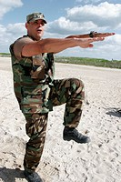 Man, military uniform, exercise leader, workout. Atlantic shore. Miami Beach. Florida. USA.