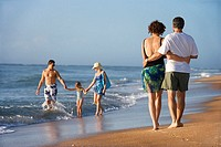 Couple and family on beach