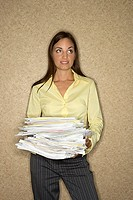 Woman holding stack of papers