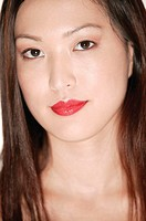 Asian woman wearing lipstick, portrait.