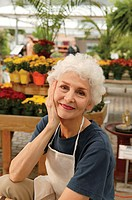 Senior woman in a garden center, portrait.