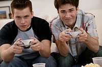 Teenagers playing videogames.