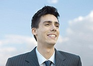 Young businessman smiling, portrait (thumbnail)