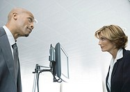 Businessman and female airline attendant staring at each other