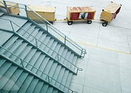 Stairs and cargo containers on tarmac