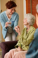 Medical worker giving woman medicine