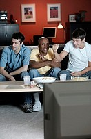 Men watching television.