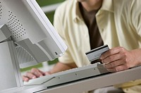 Man ordering online with credit card.