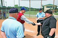 softball umpires for ASA in the US during games and in pregame checking bats and lineups and rules and such shacking hands teams