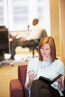 Businesswoman using a mobile phone in an office
