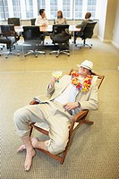 High angle view of a businessman relaxing in an office