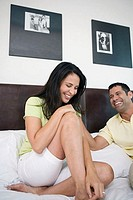 Mature couple smiling in the bed