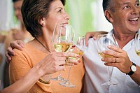 Close-up of a mature couple holding wineglasses and smiling