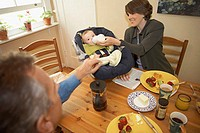 High angle view of a mid adult couple with their son at a dining table (thumbnail)