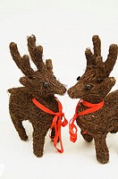 Close-up of two reindeer decorations