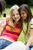 Close-up of two girls posing for a mobile camera