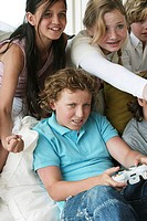 High angle view of a boy playing a video game with his friends