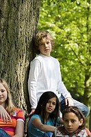 Portrait of two boys and two girls resting in a park