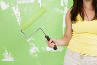 Close-up of a woman holding a paint roller