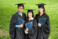 Portrait of two female graduates and a male graduate holding files