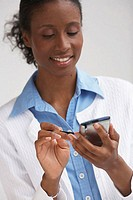 Close-up of a businesswoman using a PDA (thumbnail)