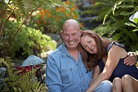 Portrait of a mature couple smiling in a garden