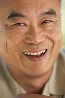 Portrait of a mature man laughing